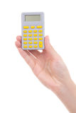 Woman hand holding pocket calculator isolated on white Royalty Free Stock Photos