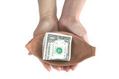 Woman hand holding pottery with single dollar note Royalty Free Stock Photo