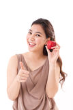 Woman with hand holding red apple, giving thumb up Royalty Free Stock Photo