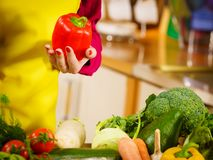 Woman holding bell peppers paprika Stock Photos
