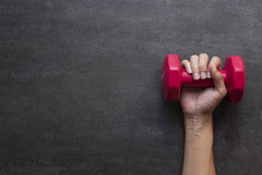 Woman hand holding red dumbbell Stock Photography