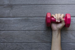 Woman hand holding red dumbbell Royalty Free Stock Image