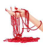 Woman Hand Holding Red Glassbeads Stock Photography