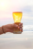 Woman hand holding a refreshing beer Royalty Free Stock Image