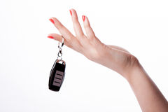 Woman hand holding remote control Stock Photos