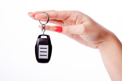 Woman hand holding remote control Royalty Free Stock Photos