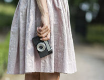Woman hand holding retro camera close-up Stock Images