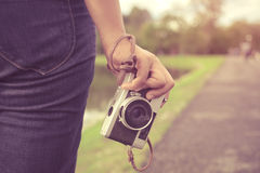 Woman hand holding retro camera. young hipster girl photographer with film camera. Close-up shot of woman hand holding retro camera. young hipster girl Royalty Free Stock Photo