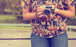 Woman hand holding retro camera. young hipster girl photographer with film camera. Close-up shot of woman hand holding retro camera. young hipster girl Stock Photography