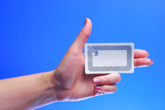 Woman hand holding RFID tag Royalty Free Stock Images
