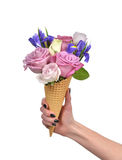 Woman hand holding roses and iris flowers in waffle cones close Stock Images