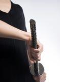Woman hand holding samurai sword on white background Royalty Free Stock Image
