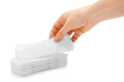 Woman hand holding sanitary napkin. Royalty Free Stock Images
