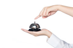 Woman hand holding Service bell and press button Stock Photo