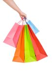 Woman hand holding several shopping bags. Isolated on white Royalty Free Stock Image