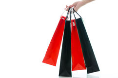 Woman hand holding shopping bag on white background Stock Photos