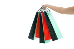 Woman hand holding shopping bag on white background Stock Photography