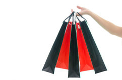 Woman hand holding shopping bag on white background Stock Images