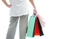 Woman hand holding shopping bag on white background Royalty Free Stock Image