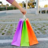 Woman hand holding shopping bags Stock Photography