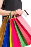 Woman hand holding shopping bags and credit or debit card Stock Photo