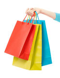 Woman hand holding shopping bags Royalty Free Stock Photography