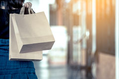 Woman hand holding shopping bags on the street royalty free stock photography