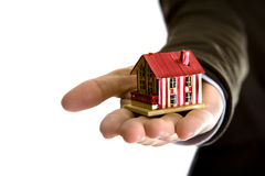 Woman Hand Holding Small House Stock Photography