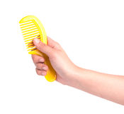 Woman hand holding small plastic comb isolated on white Stock Image