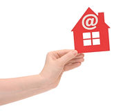 Woman hand holding small red plastic house Royalty Free Stock Image