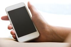 Woman hand holding a Smart Phone Stock Image