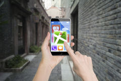 Woman hand holding smart phone finger touching map icon Stock Photography