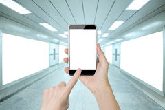 Woman hand holding smart phone finger touching white screen Royalty Free Stock Photo