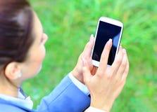 Woman hand holding smartphone Stock Photos