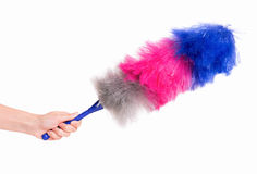 Woman hand holding soft duster. Hand holding broom for cleaning or soft colorful duster with plastic handle, isolated on white background. Cleaning woman holding Royalty Free Stock Photos