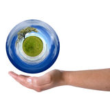 Woman hand holding sphere with spring landscape Stock Image
