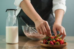 Woman hand holding strawberries Stock Photos