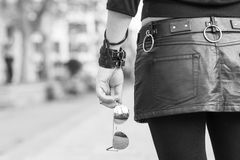 Woman hand holding sunglasses, black and white photography. Stock Photography