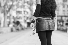 Woman hand holding sunglasses, black and white photography. Royalty Free Stock Photography