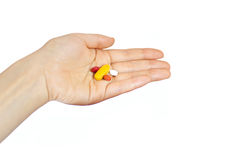 Woman hand holding supplements Stock Photo