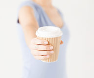 Woman hand holding take away coffee cup Royalty Free Stock Photography