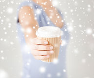 Woman hand holding take away coffee cup Stock Images