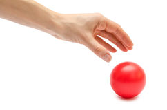 Woman hand holding toy ball. Royalty Free Stock Images