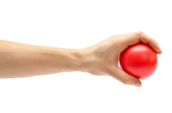 Woman hand holding toy ball. Stock Photo