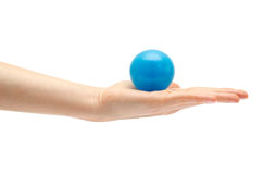 Woman hand holding toy ball. Stock Images