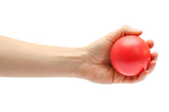 Woman hand holding toy ball. Royalty Free Stock Photography