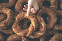 Woman hand holding Turkish bagel. Woman hand holding  Turkish bagel Stock Photos