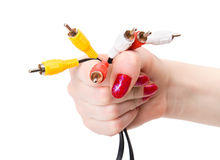 Woman hand holding tv cable pins Stock Photography