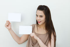 Woman hand holding two black cards envelope size royalty free stock photography