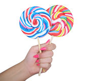Woman hand holding two lollipops Royalty Free Stock Photography